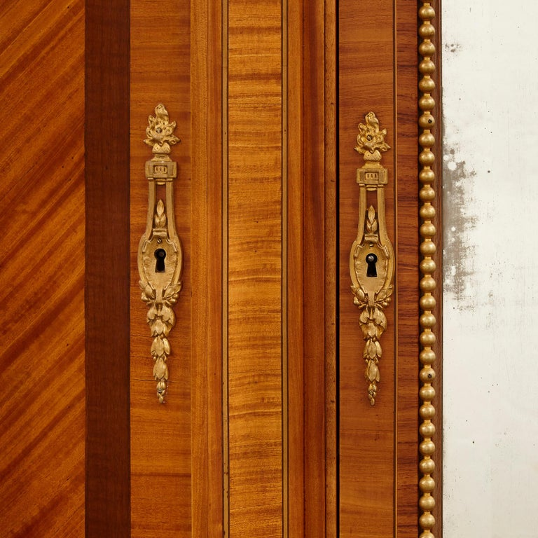 French Large Parisian Wardrobe Adorned with Marquetry and Gilt Bronze For Sale