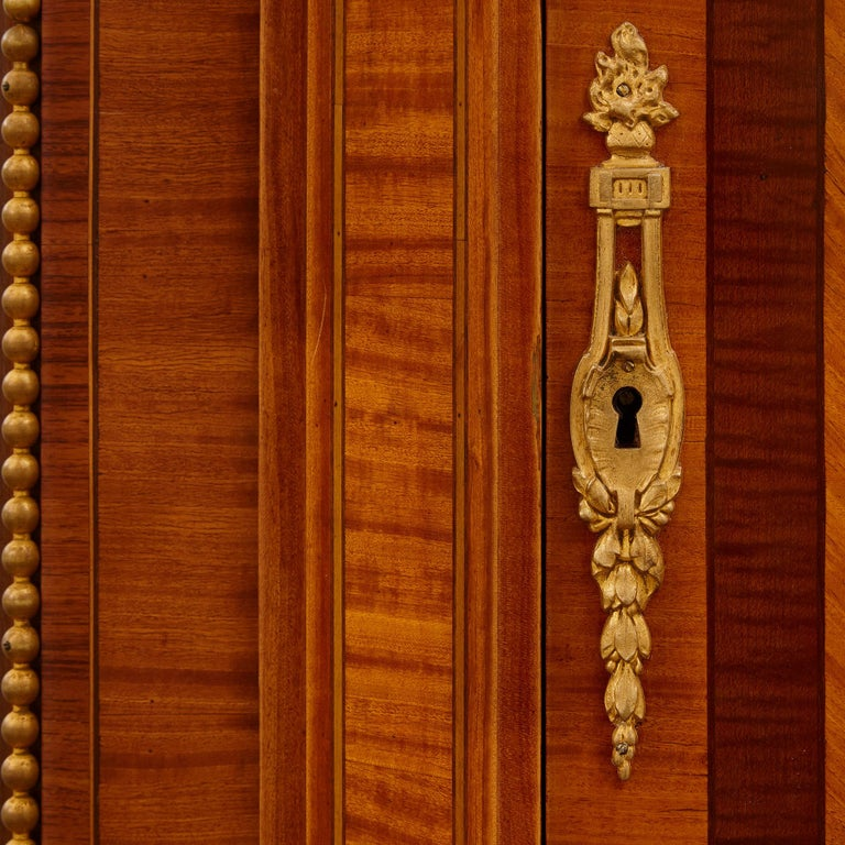 Large Parisian Wardrobe Adorned with Marquetry and Gilt Bronze For Sale 1