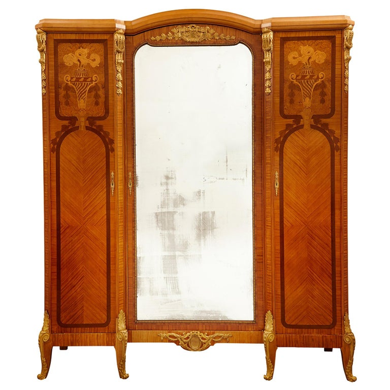 Large Parisian Wardrobe Adorned with Marquetry and Gilt Bronze For Sale