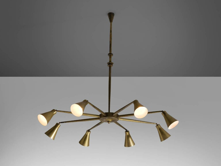 Pendant attributed to Giuseppe Ostuni, brass, Italy, circa 1958.  This brass, large eight-armed pendant is attributed to Giuseppe Ostuni for O-Luce. The lamp is both modern and Classic at the same time. A trait that Italian lights often achieve.