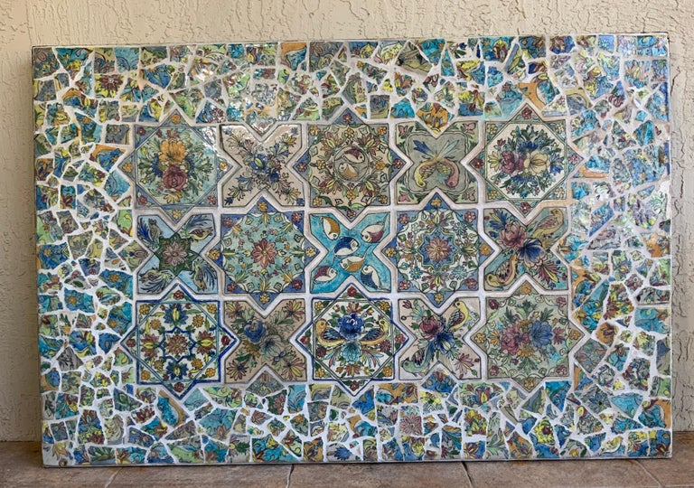 One of a kind wall hanging professionally made of solid steel frame ,imbedded with beautiful antique hand painted Persian ceramic tiles, flowers, vines and birds motifs. Beautiful colors of green, blue, yellow, and fantastic turquoise , surrounded