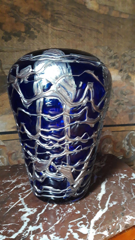 Large pewter mounted blue crystal vase.