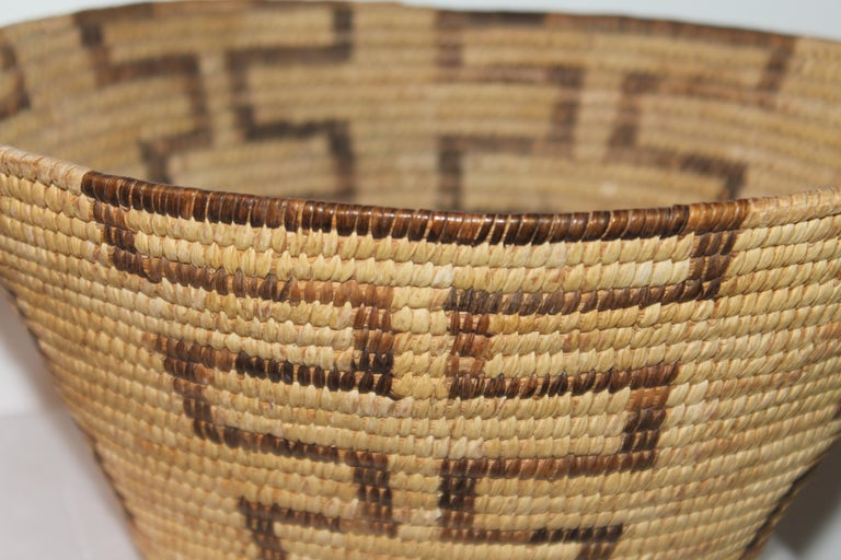 This fine American Indian basket is in fine condition and has a geometric design.