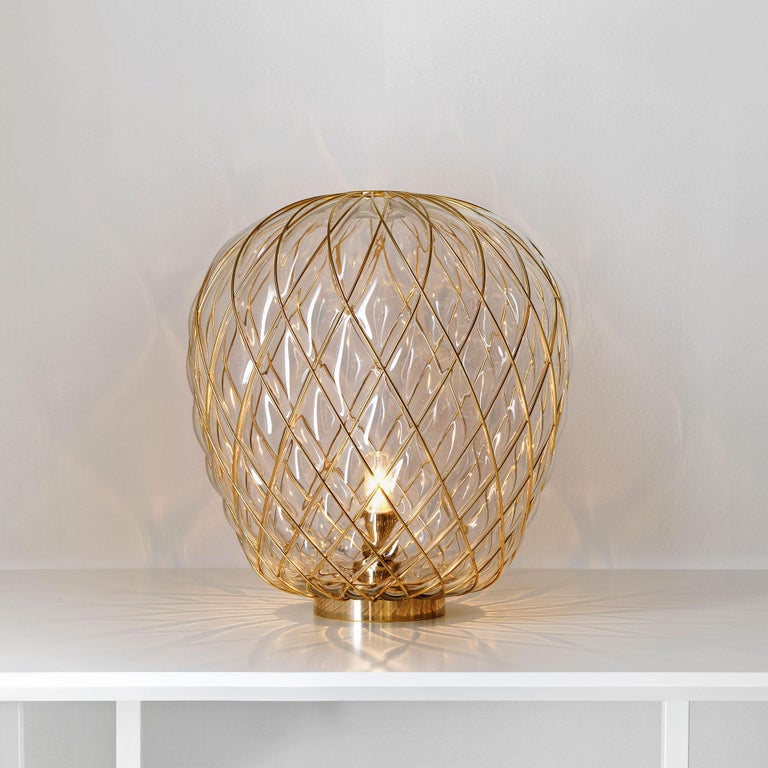 Large 'Pinecone' table lamp in translucent glass & gold metal for Fontana Arte. Designed by Paola Navone, the Pinecone comes in both a suspension and table lamp. The diffuser is manufactured using the ancient caged blown glass technique: the glass