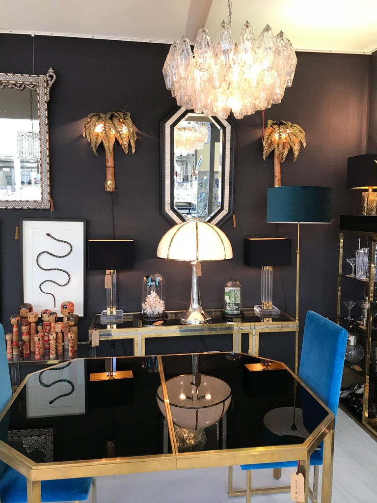 A large poliedri chandelier by Carlo Scarpa for Venini, with 65 large, 18cm high, clear glass Poliedri drops suspended from chromed metal frame with seven-light fittings. Re wired with new fittings and PAT tested. The frame has been re-sprayed in