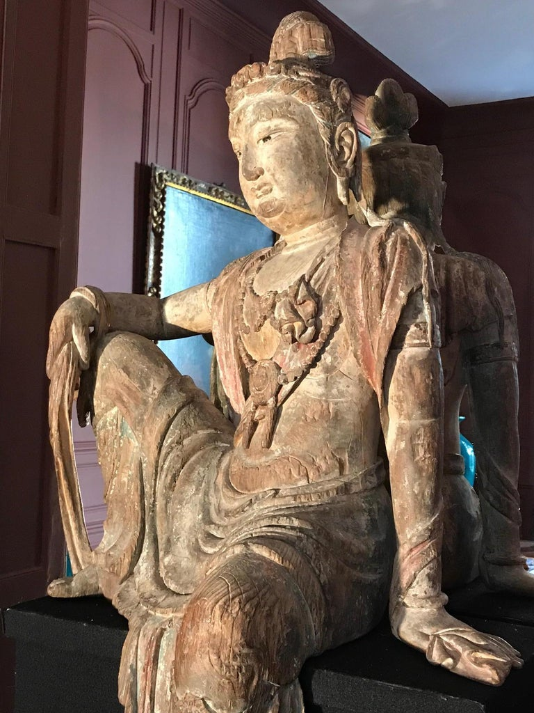 A large polychrome wood figure of Guanyin, China, Qing dynasty, 19th century, from a private collection, directly bought in China in 1980 by the former owner for his Parisian apartment.  His collection was supervised by the famous Daniel Pasgrimaud,