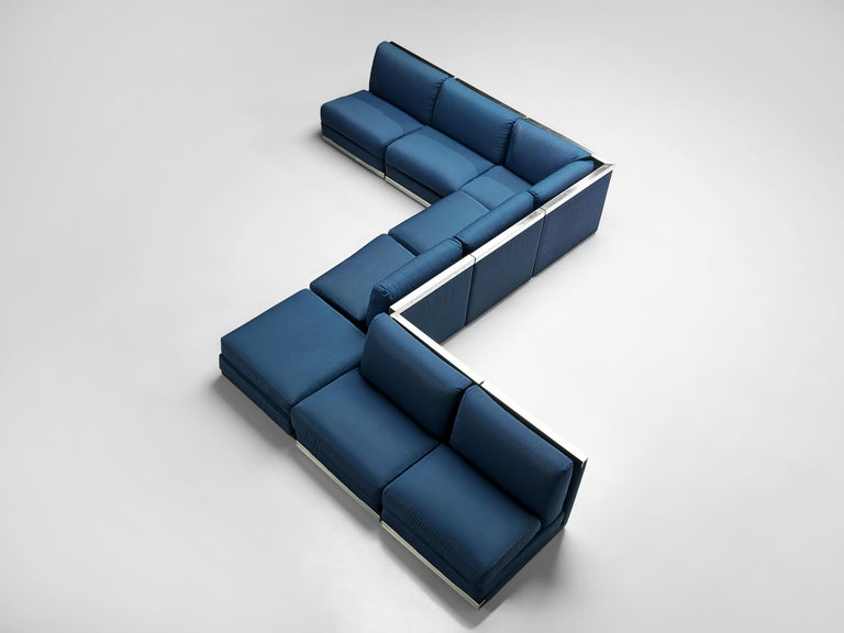 Sectional sofa, cobalt blue fabric upholstery, aluminum, Italy, 1980s  Large Postmodern modular sofa, consisting of 6 straight seating elements, one corner and an element without backrest usable as a side table or ottoman. A perfect piece to place