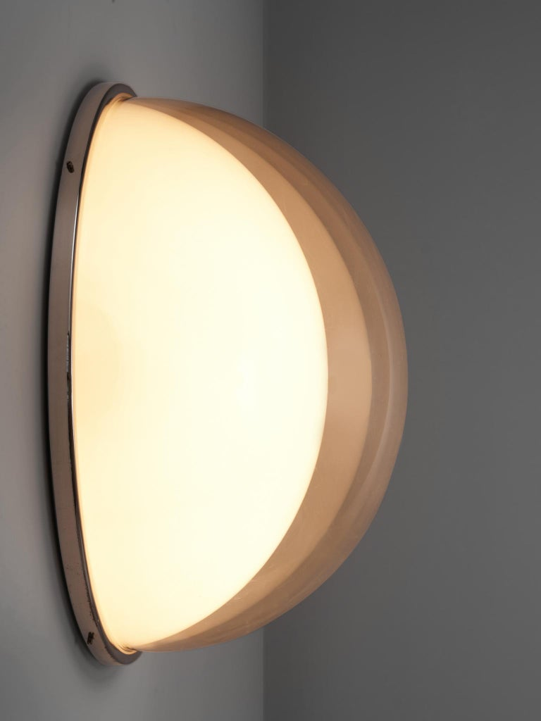 Wall light, metal, glass, Italy, 1950s  A refined shaped and elegant wall light that could also be used as a ceiling lamp. The rounded light consists out of one opaline half sphere which is overlapped by another see through half sphere. this