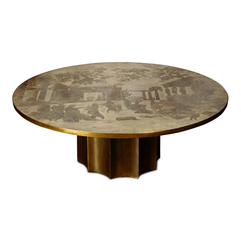 This is a rare and large 47.25 inch Odyssey cocktail table by father and son team, Philip and Kelvin LaVerne, produced in the 1960s. Ingeniously designed with acid etching and patinated polychrome bronze and pewter, this circular coffee table