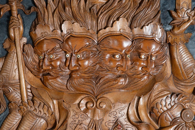 A fine quality late 19th century Meiji period (1868-1912) carved hard wood Japanese wall panel depicting four bearded warriors on the back a mythical cat like creature.