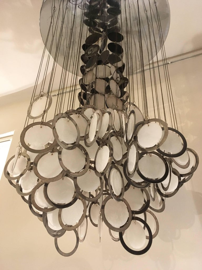 Large Murano hanging lamp with one cluster of white opal molded mother-of-pearl glass discs in a chromed ring. Attached by chains of small metal rings and one tier of metal chromed discs which gives a special sparkling light effect,hanging from a