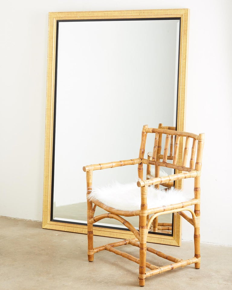Spectacular wall mirror featuring a thick beveled looking glass. The beautiful gilt wood frame has a receded style texture with a rich patina. Accented by a subtle black trim border this large rectangular mirror is mounted with hardware to be hung