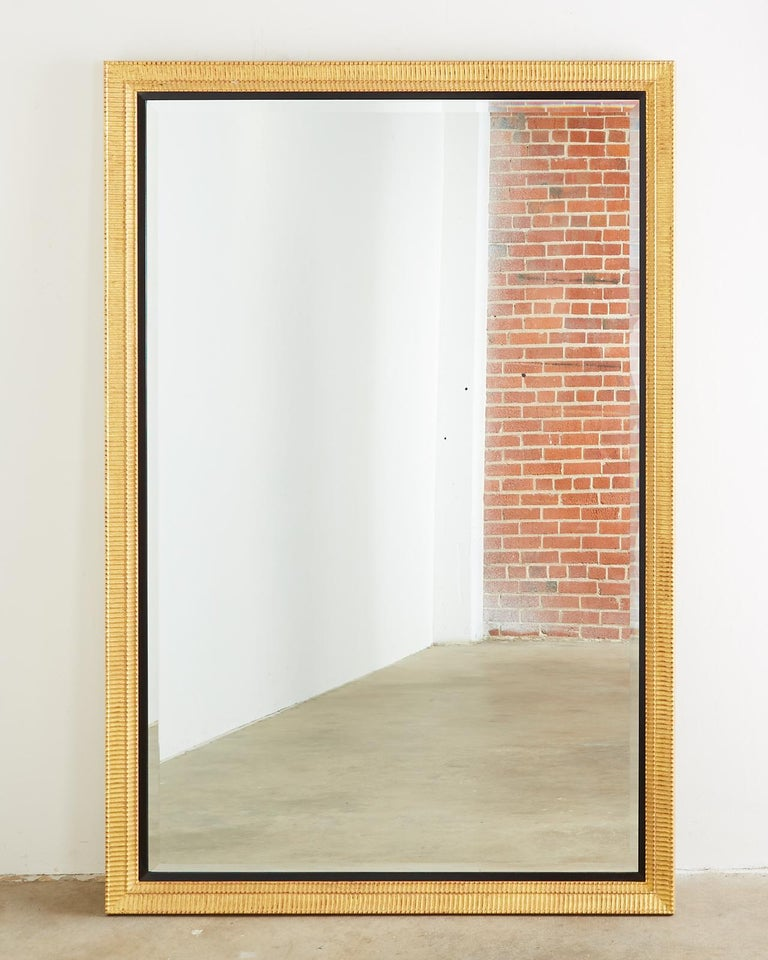 Hollywood Regency Large Rectangular Gilt Wood Wall Mirror with Beveled Glass For Sale