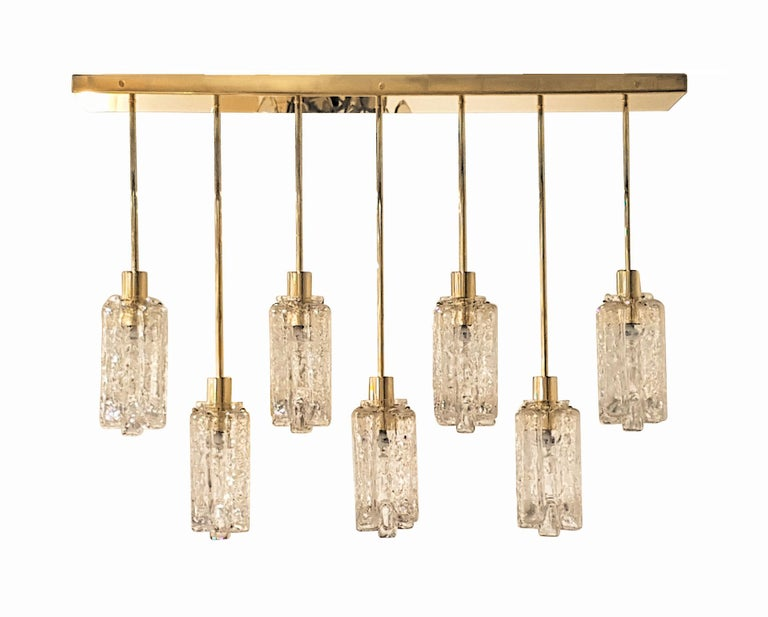 Large rectangular Murano textured clear glass pendants and brass flushmount ceiling light. Frame made to order: 7 weeks lead time maximum. Limited edition: 140 pieces of Mid-Century Modern glasses only. The Murano glass textured clear vases, are