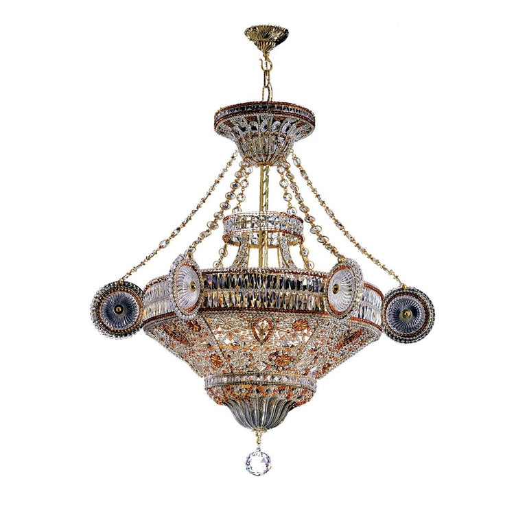 A whimsical design, masterful craftsmanship, and the use of exquisite materials make this chandelier a superb addition to any home. Made of forged iron, the structure is adorned with Bohemian crystals both clear and red, which were handwoven thanks