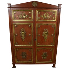 Large Red Lacquered wardrobe with gilded figures in relief