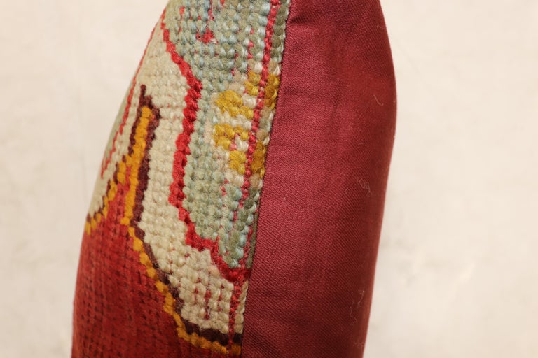 Pillow made from an antique Turkish Oushak rug from the early 20th century.  Measures: 19