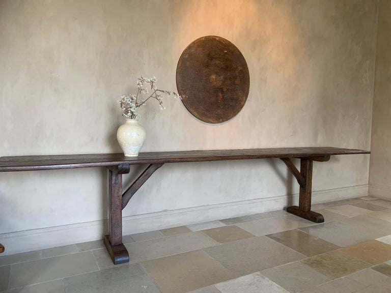 A large 19th century Pyrinee console table. The beautifully patined one slab elm top on softwood trestles. Tables like these were made for centuries in largely the same manner. Knowhow and sense for proportion was handed down for generations.