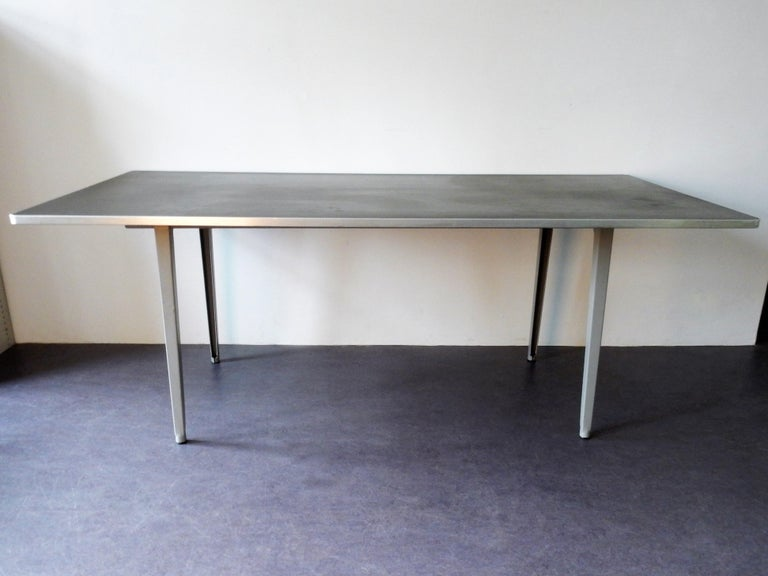 The famous 'Reform' table was designed by Friso Kramer for Ahrend de Cirkel in 1955. This table is a true Dutch design in a very nice condition. At the mark on the solid metal frame you can see it was specially made for delft University of
