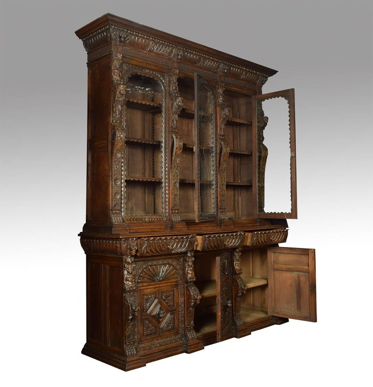 English Large Renaissance Revival Carved Oak Three-Door Bookcase For Sale