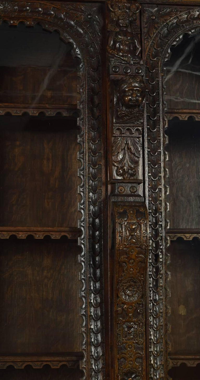 Large Renaissance Revival Carved Oak Three-Door Bookcase In Good Condition For Sale In Cheshire, GB