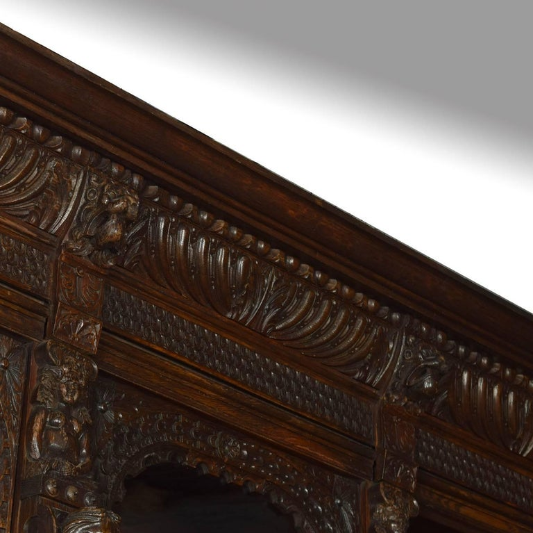 19th Century Large Renaissance Revival Carved Oak Three-Door Bookcase For Sale