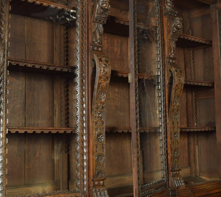 Large Renaissance Revival Carved Oak Three-Door Bookcase For Sale 4