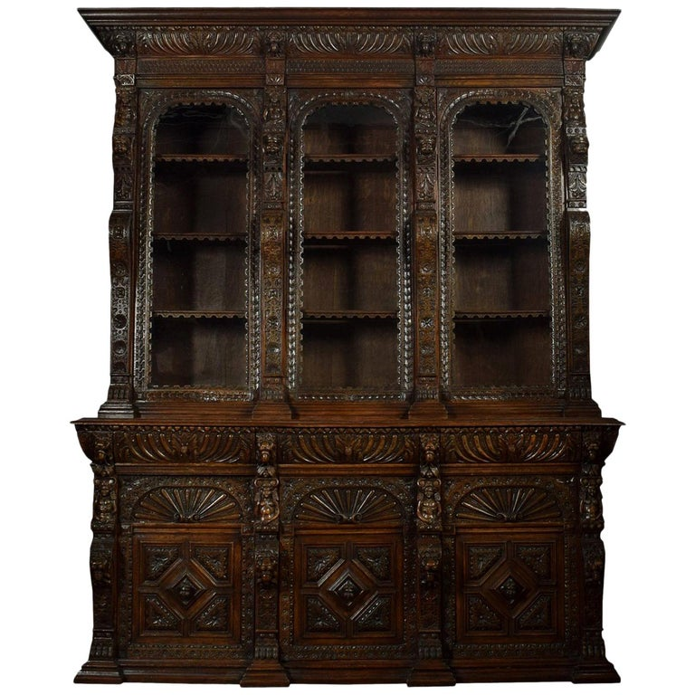 Large Renaissance Revival Carved Oak Three-Door Bookcase For Sale