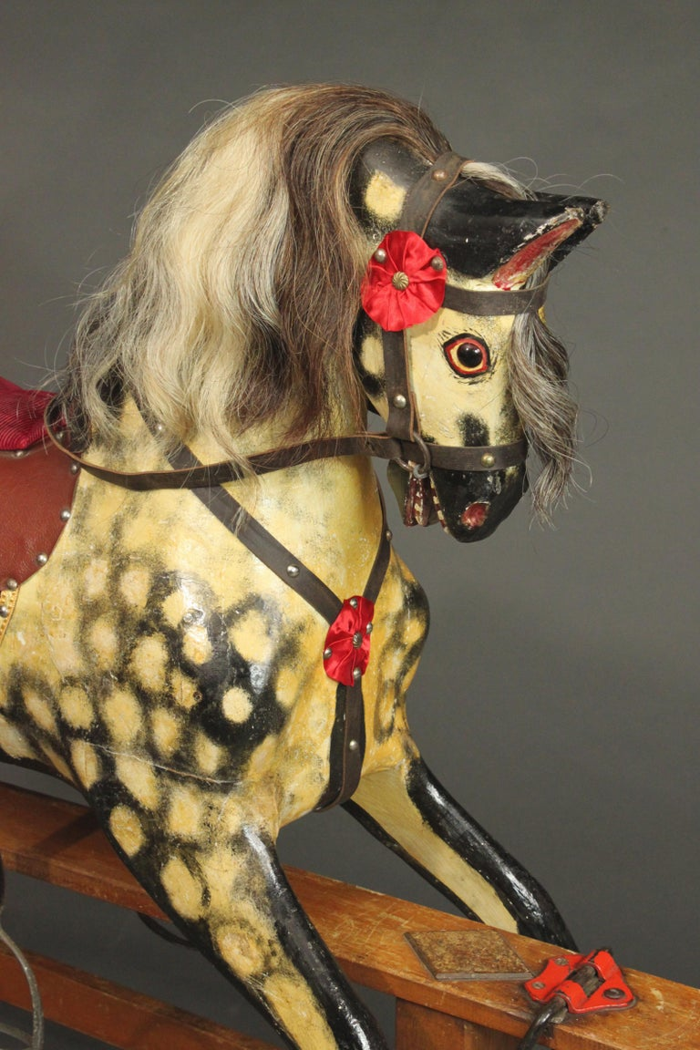 A large antique rocking horse made by Collinson in circa 1950. Collinson has been making rocking horses since 1835, but most of the ones that have survived date from the post-war period. The paintwork is original and has had minor resoration, the