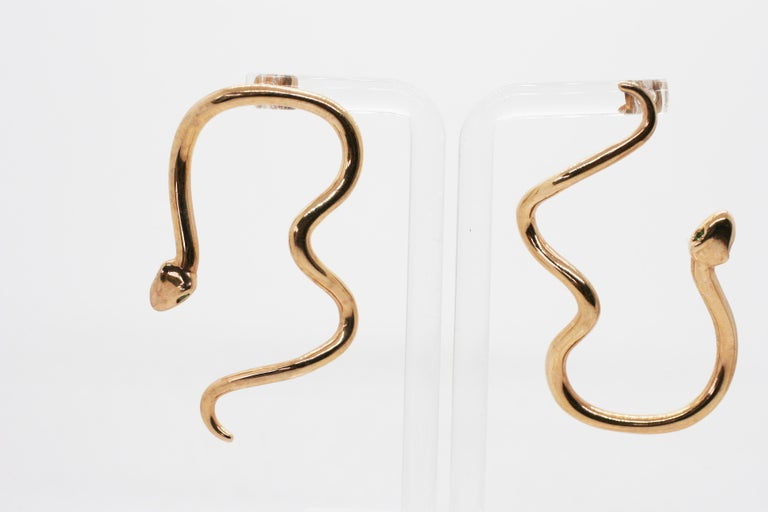 Large Rose Gold Plated Sterling Sliver Signature Snake Hoops feature two oversize curved snakes that frame the face in alternating directions with green tsavorite eyes Includes earring backings Sold as a Pair