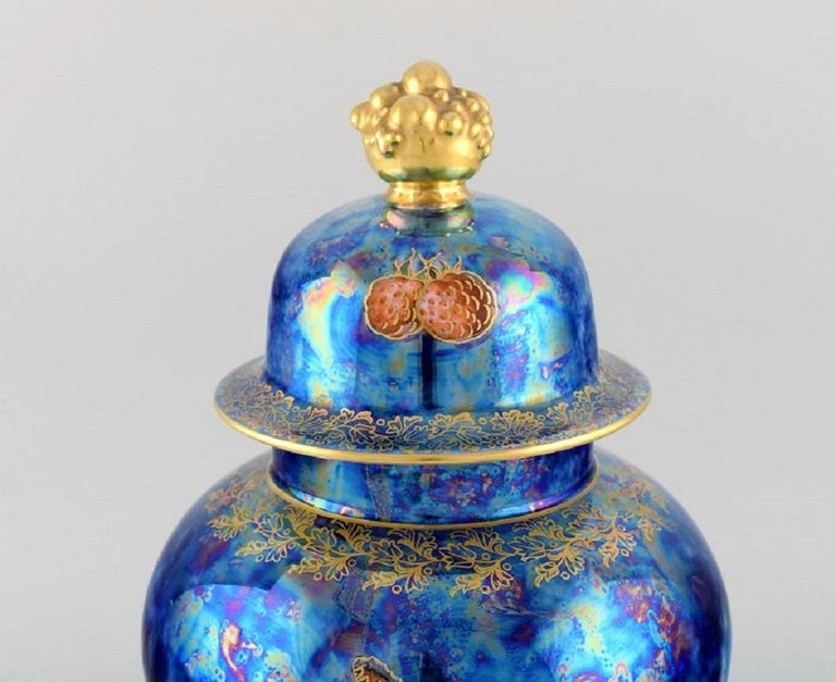 Large Rosenthal lidded jar in blue glazed porcelain with hand-painted fruits, butterflies and gold decoration.  1920s / 30s. Measures: 31.5 x 20 cm. In excellent condition. Stamped.