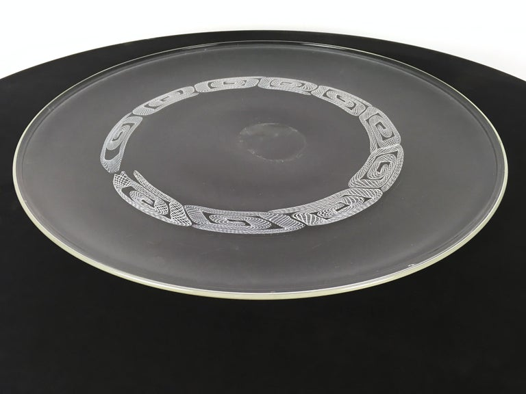 It's made in blown glass by Seguso, Murano, Italy; a blown mark is visible in the center of the plate. It may show slight traces of use since it's vintage, but it can be considered as in very good original condition and ready to become a piece in a