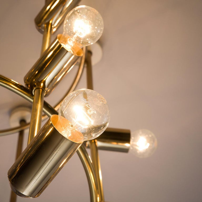 Mid-20th Century Large Round Swiss Chandelier in Brass For Sale