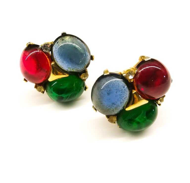 A beautiful pair of very wearable cabuchon earrings from Ciner, with three large stones, of sapphire, ruby and emerald glass, set in gilt metal, with three single clear paste highlights. Chic and versatile, these are a classic Ciner design from this