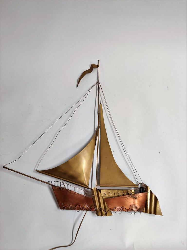 Large, handmade copper and brass wall light sculpture in the shape of a sailing ship by Belgian artist Daniel Dhaeseleer.   The piece is signed at the front. Two screw bulb light fittings are worked into the frame, creating a wonderful shadow