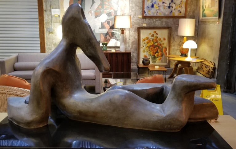 Impressive, large scale cubist female nude figure cast in solid bronze measuring 38.5 inches in width. Artist signed. This is a heavy, substantial sculpture with fine craftsmanship and patina executed in the abstract or cubism style. I have