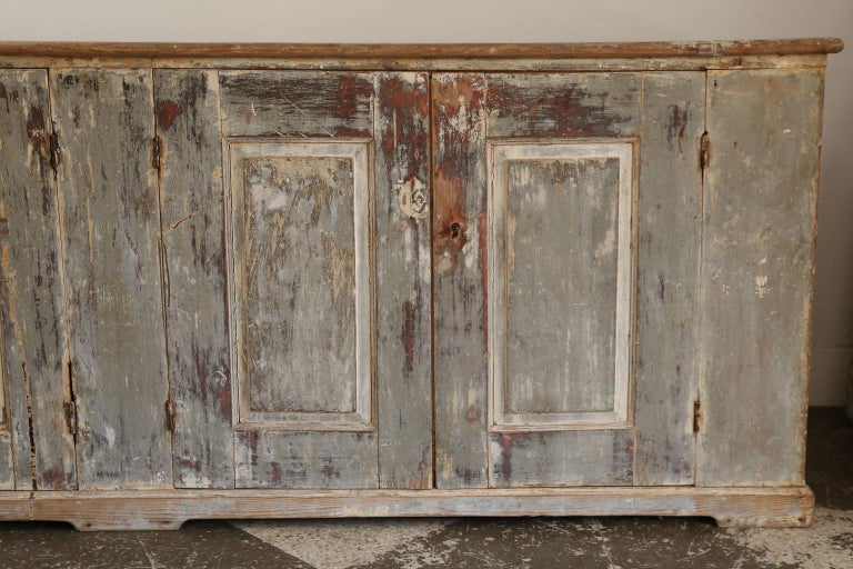 Large-scale French enfilade with four doors, working locks and two keys. Remnants of gorgeous bluish gray and beige paint.