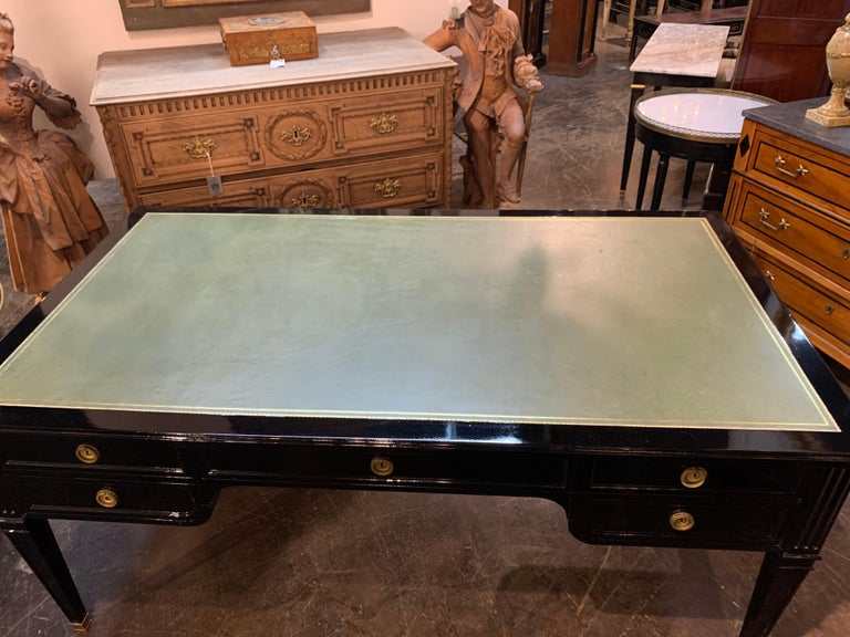 Very fine large scale French Maison Jansen style black lacquered bureau plat desk. Nice green leather on the top of the desk. Beautiful polished look makes an stylish statement. True elegance!