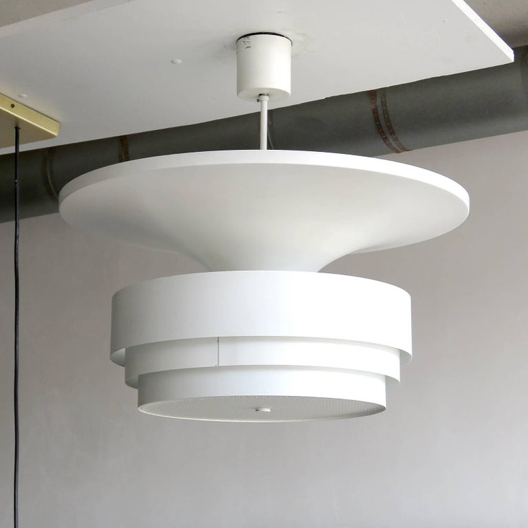 Minimalist large-scale pendant light by Hans-Agne Jakobsson for Markaryd, Sweden, multi-tiered white enameled metal body with textured acrylic bottom diffuser, marked.