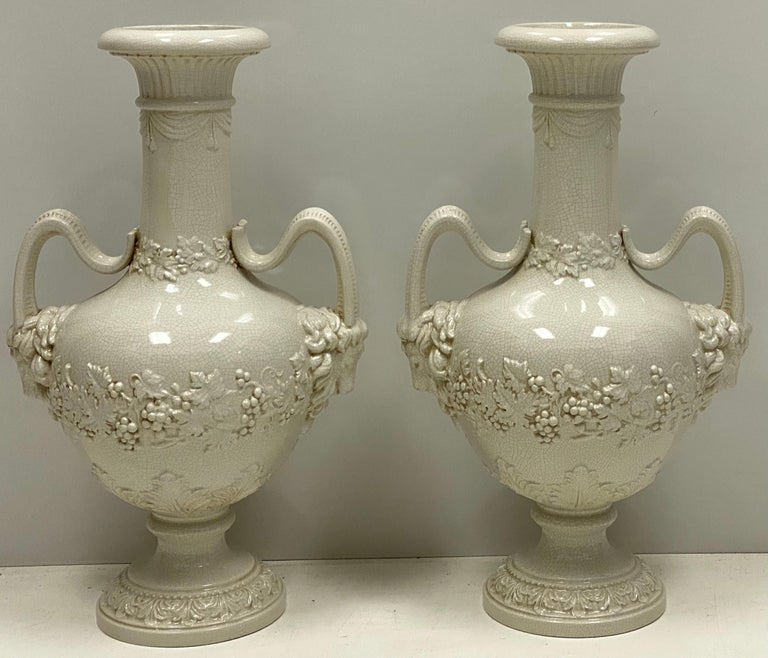 Ceramic Large Scale Italian Neoclassical Style Urns or Vases with Ram's Heads, a Pair For Sale