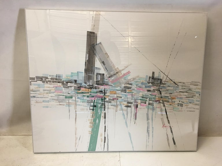 Beautiful watercolor abstract cityscape by Rodolfo, 1986. The work is beautifully framed in a white edged acrylic box-frame. Measures 48 x 40 x 2