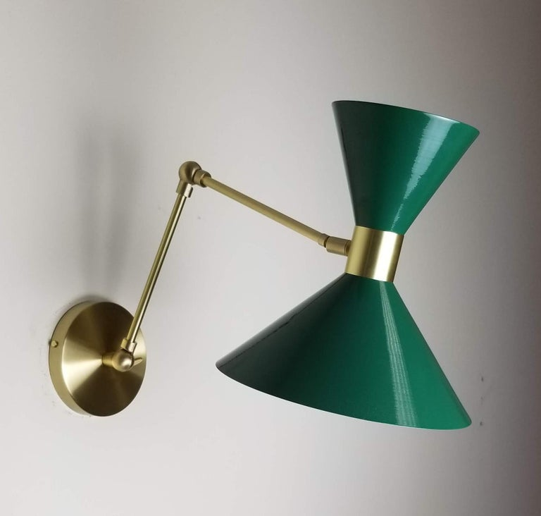 Monarchlarge scale wall-mount reading lamp or sconce with articulated arms shown in natural brass and our luxe dark green