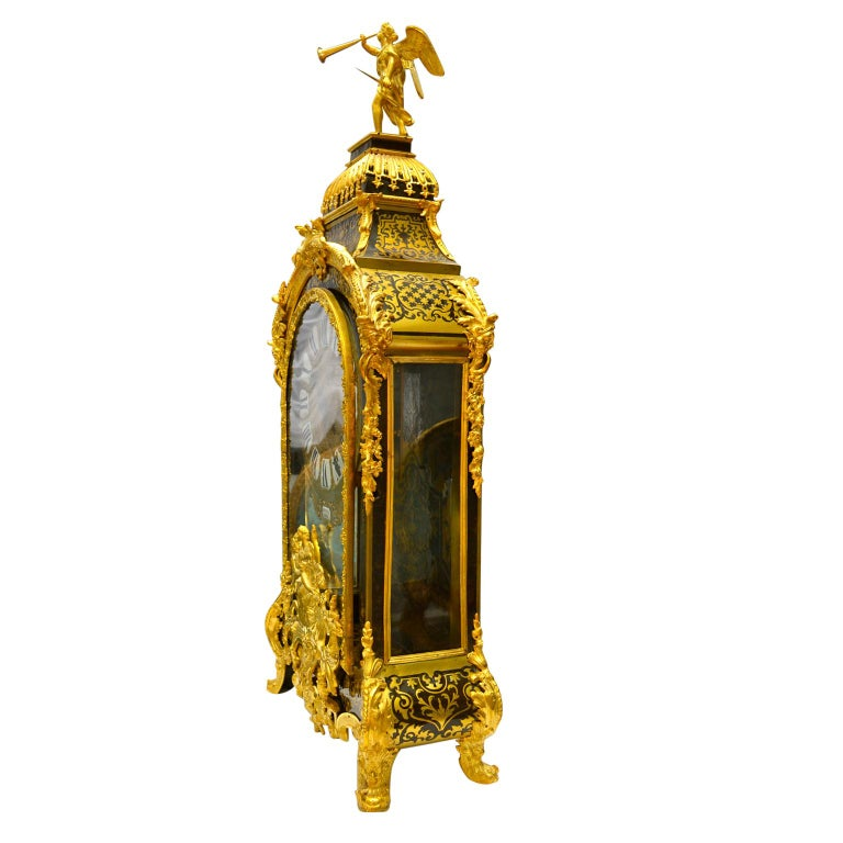 Grand scale boulle Cartel clock and matching plinth, the case in tortoiseshell and embellished all-over with gilded bronze mounts (re-gilt). The medallion below the clock dial shows a centaur (half man, half horse) carrying off a young maiden. On