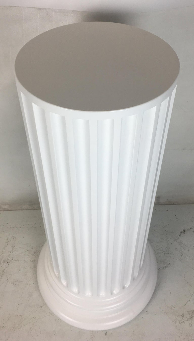 Beautifully rendered vintage plaster column-form pedestal. We have refinished the column in white lacquer and we'd be happy to adjust the color to the buyer's specification.   Dimensions: Bottom 21