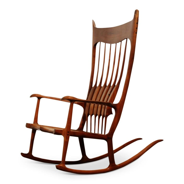 An incredibly stunning large scale studio rocking chair by Charles Jacobs, signed and dated 11-8-85.   This monumental Sam Maloof style craftsman chair was handcrafted with solid, heavily grained, hardwood, which was expertly finished with