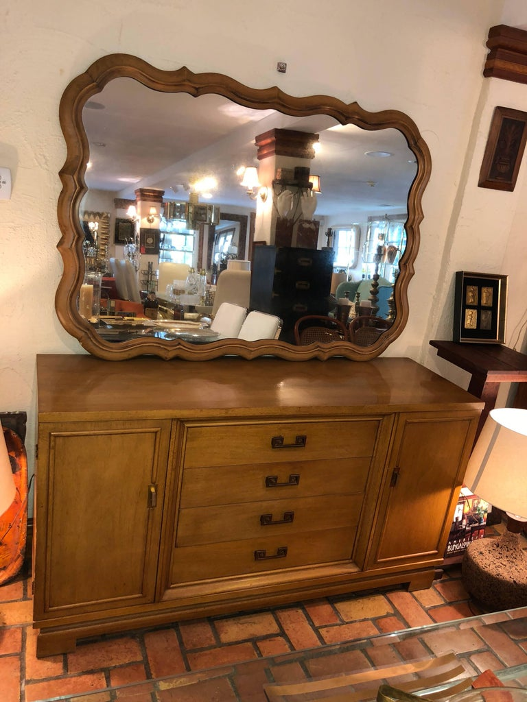 Large scalloped fruitwood mirror. Solid wood construction . It looks gorgeous above our matching wooden Henredon credenza. They match perfectly. The mirror has a slight smoky finish to the glass.  This is intentional. Please inquire about dealer