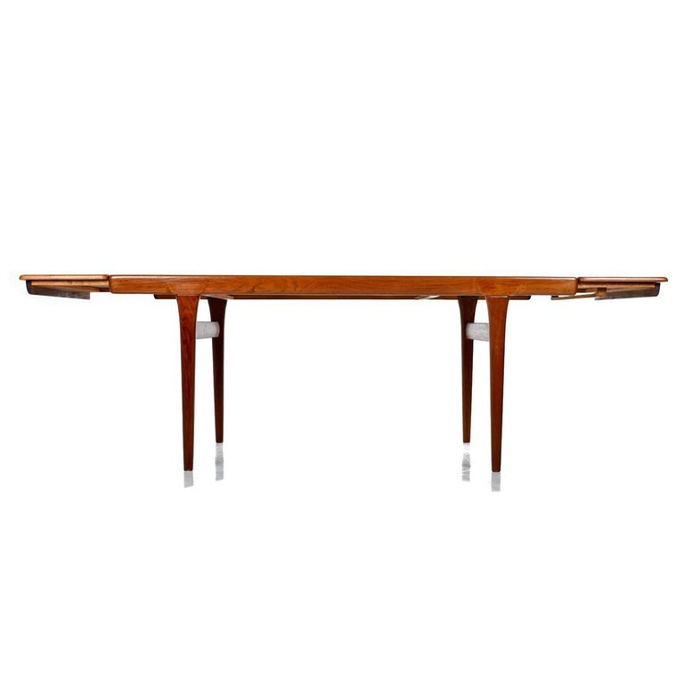 Danish Large Scandinavian Modern Teak Draw Leaf Expanding Dining Table, circa 1960s For Sale