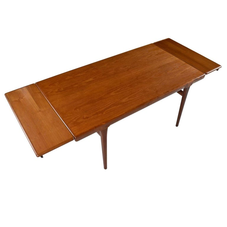 Large Scandinavian Modern Teak Draw Leaf Expanding Dining Table, circa 1960s For Sale