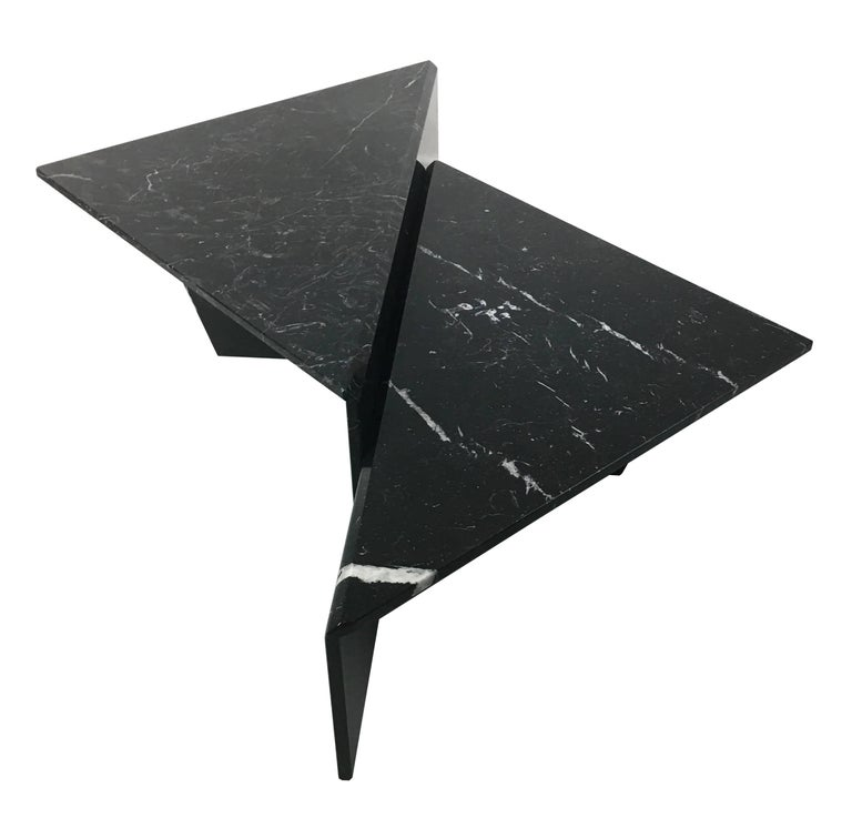 Fantastic sculptural two-piece, bi-level cocktail table in beautifully figured Nero Marquina marble. The table can be configured in a number of ways to compliment your seating with a super-chic 1970s vibe. All of the corners and joints are mitered