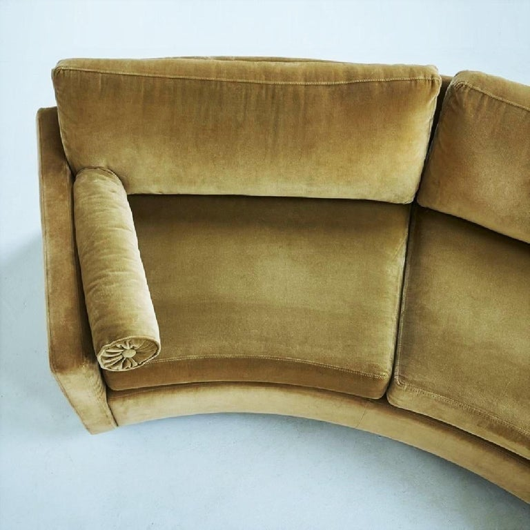 Clean, Minimalist two-piece semi circular sofa, model no 825 designed by Milo Baughman for Thayer Coggin, circa 1968. Comfortable deep seats and low slung profile. Newly upholstered in velvet with loose back and seat cushions resting on dark stained